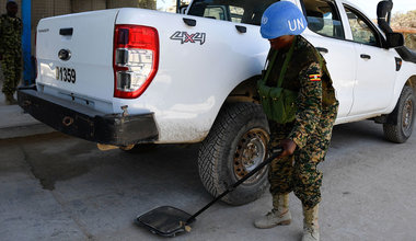 UN Photo/Ilyas Ahmed A female Ugandan soldier serving under the United Nations Guard Unit (UNGU) in Somalia, searches a vehicles at a checkpoint in Mogadishu.